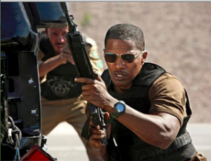 Jamie Foxx wielding an assault rifle