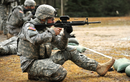 U.S. Army Spc. Joshua Sellers, assigned to 615th Military Police (MP) Company, 18th MP Brigade, fires his M4 carbine rifle during weapons qualification at the 7th Army Joint Multinational Training Command's Grafenwoehr Training Area, Germany, Jan. 16, 2014. (U.S. Army photo by Visual Information Specialist Markus Rauchenberger/released)