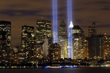 """The """"Tribute in Light"""" memorial is in remembrance of the events of Sept. 11, 2001. The two towers of light are composed of two banks of high wattage spotlights that point straight up from a lot next to Ground Zero. This photo was taken from Liberty State Park, N.J., Sept. 11, the five-year anniversary of 9/11. (U.S. Air Force photo/Denise Gould)"""