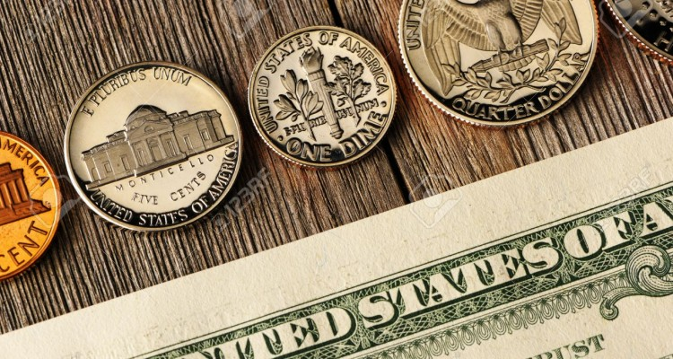 19525990-New-uncirculated-US-money-over-wooden-background-Stock-Photo