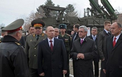 Russia's President Vladimir Putin (3rd L) and his Armenian counterpart Serzh Sarksian (3rd R) visit the Russian military base in the Armenian city of Gyumri, on December 2, 2013. Putin is on a visit to Armenia. AFP PHOTO/ RIA-NOVOSTI/ POOL / ALEXEI NIKOLSKY (Photo credit should read ALEXEI NIKOLSKY/AFP/Getty Images)