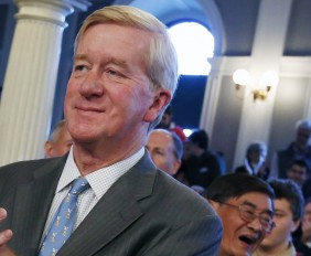 Former Massachusetts Gov. William Weld, second from right, applauds along with comedian Lenny Clarke, left, Republican candidate in the Massachusetts 6th congressional district, Richard Tisei, second from left, and daughter of Sen. Scott Brown, R-Mass., Ayla Brown, right, during a campaign rally for Scott Brown at Faneuil Hall in Boston, Sunday, Nov. 4, 2012.  Brown and Democratic challenger Elizabeth Warren are urging supporters to work as hard as they can in the final days of the campaign to get their voters to the polls. (AP Photo/Michael Dwyer)
