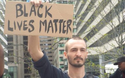 White-Man-Hold-Black-Lives-Matter-Sign-e1435887933350