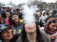 FILE - In this April 19, 2014 file photo, partygoers dance and smoke pot on the first of two days at the annual 4/20 marijuana festival in Denver. The annual event is the first 4/20 marijuana celebration since retail marijuana stores began selling in January 2014. Colorado is now selling more recreational pot than medical pot, tax records released Wednesday, Sept. 10, 2014 show. The state sold $29.7 million worth of recreational marijuana in July, the most recent data available, slightly higher than the $28.9 million worth of medical marijuana sold in the same month. (AP Photo/Brennan Linsley, File)