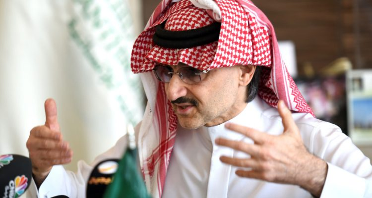 "Saudi Arabia's billionaire Prince Alwaleed bin Talal gestures during a press conference in the Saudi capital, Riyadh, on July 1, 2015. Alwaleed pledged his entire $32-billion (28.8-billion-euro) fortune to charitable projects over the coming years. The prince said in a statement that the ""philanthropic pledge will help build bridges to foster cultural understanding, develop communities, empower women, enable youth, provide vital disaster relief and create a more tolerant and accepting world."" AFP PHOTO / FAYEZ NURELDINE        (Photo credit should read FAYEZ NURELDINE/AFP/Getty Images)"