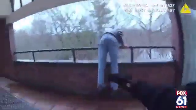 Dramatic body cam video shows officer save man from jumping off roof