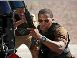 Jamie Foxx wielding an assault rifle
