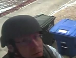 An officer destroys a security camera to cover his tracks.