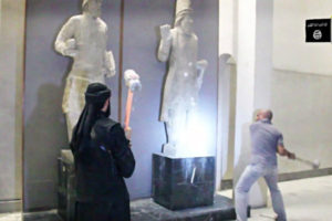 ISIS militants destroying ancient Babylonian statues