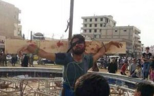 Local Christian leader was tortured prior to his public crucifixion in the Syrian capital of Damascus.