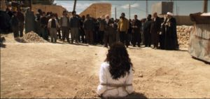 Islamic State officials gathering a crowd to stone a woman accused of adultery