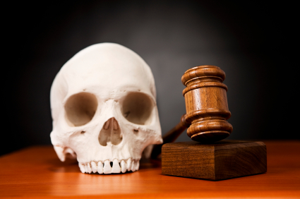 Human skull with judge's gavel and sounding block. Symbolizes harsh justice, death penalty, etc. Camera: Canon EOS 1Ds Mark III.