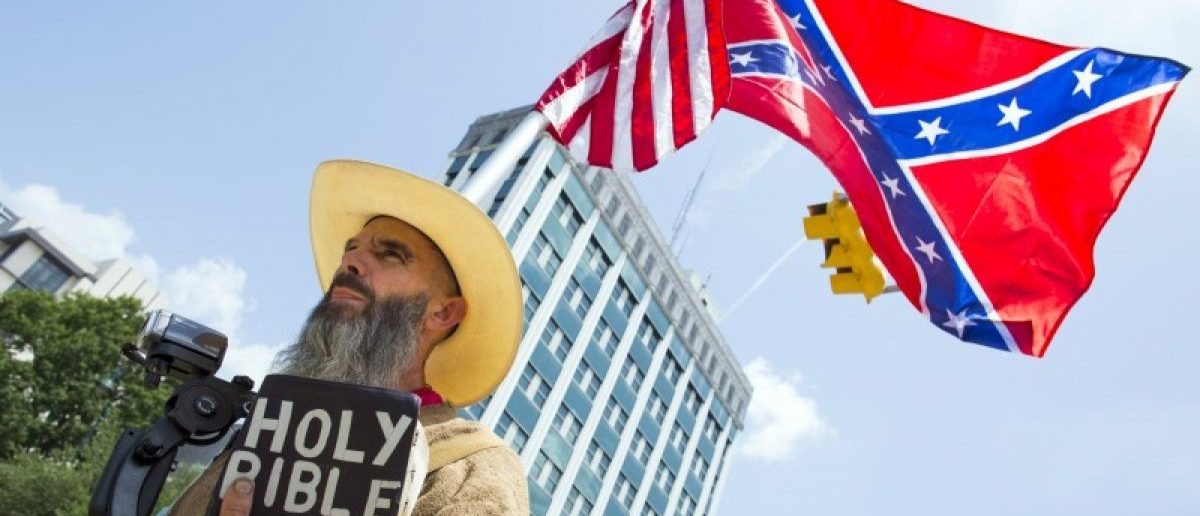 BLM Leader Arrested For Trying To Steal Confederate Flag From Protester